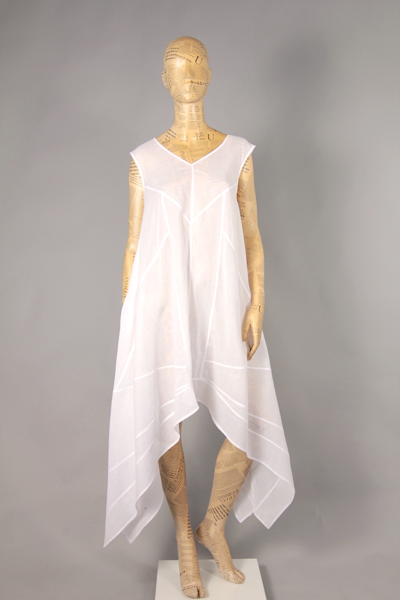 WHITE DRESS WITH STRAP AND DECORATIVE SKILLET